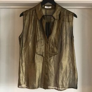 Equipment: 100% Silk gold sleeveless shirt
